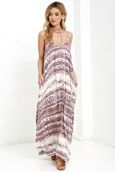 Visions of meadows, soft wind, and cattails are brought to mind by the Yours Tule Mauve Tie-Dye Maxi Dress! This elegantly simple Boho maxi is composed of lightweight woven fabric decorated with mauve tie-dye print. Relaxed-fit bodice falls from adjustable spaghetti straps and V neck. Hidden front pockets are an added convenience.