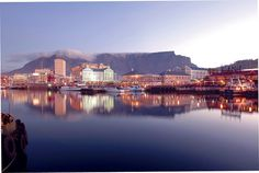 Situated in the heart of Cape Town's working harbour with the dramatic backdrop of Table Mountain, the Victoria and Alfred Waterfront is widely acknowledged. Beautiful Places In The World, Most Beautiful Cities, V&a Waterfront, Table Mountain, Out Of Africa, Most Visited, Cape Town, Wonders Of The World, Travel Guide