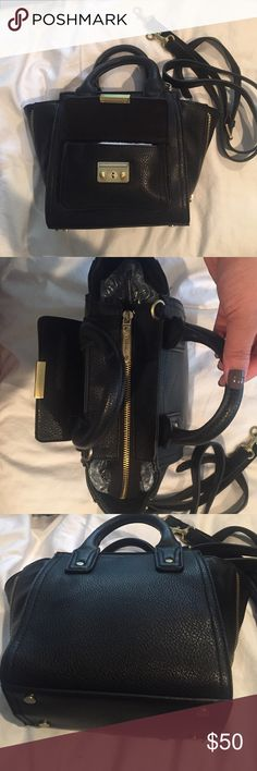 3.1 Philip lim for target pashli black gold used 3.1 Philip lim for target pashli black gold used broken magnetic front closure. Otherwise, excellent condition. Little squished from storage. Open for offers! 3.1 Phillip Lim for Target Bags Crossbody Bags