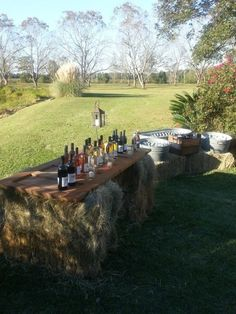 bar made from haybals | Bar from old door, galvenized tubs, and hay bales