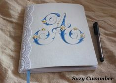 Adorable composition book makeover tutorial! Apply homemade starch to fabric, then use inkjet to print any design. Glue fabric onto book, color and embellish with lace and pearls.