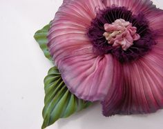 shibori flower. I could see this one as a brooch or on a necklace.