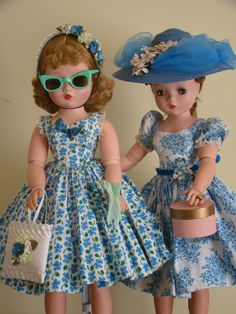 Sister Cissys in coordinating blue dresses.