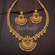 Beautifully Crafted #antique necklace studded with #green and white stones and plated with #gold polish