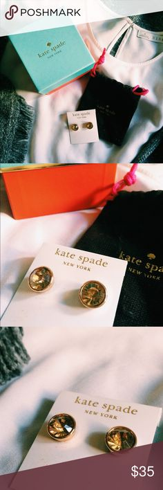 Kate Spade Topaz Circle Studs Beautiful gold plated circle studs, topaz amber color. Comes with both original backings and earring board from Kate Spade. Went a little overboard over the years buying Kate Spade studs so just trying to trim down :) price is firm kate spade Jewelry Earrings