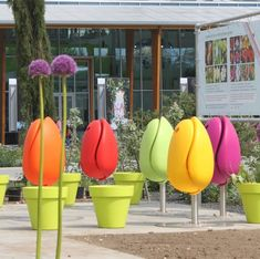 Imagine how delightful city life would be if, instead of parking your butt on a bench, you could land on a flower like a bee hunting pollen.  That's actually possible in Europe and many other places thanks to Tulpi, a Dutch company that makes a tulip-shaped street chair.