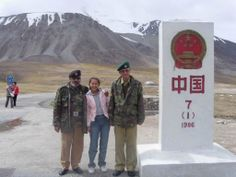 Pakistani border guards posing with a Chinese girl at the China-Pakistan border.