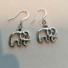 "Elephant Earrings Elephant earrings brand new silver plated over zinc/copper alloy lead nickle and cadmium free  charm measures 1"" Jewelry Earrings"