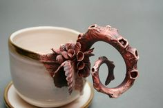 "As if lifted from the wreckage of the Titanic, ceramic artist Mary O'Malley creates sculptural porcelain teapots, cups, and vases adorned with barnacles, tentacles, and other living sea creatures (she refers to them as ""porcelain crustaceans""). Many original works from"