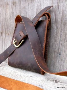 Rugged, distressed, cowhide leather that looks like it has been someones favorite bag but it is brand new. Unlined with one inside drop in pocket. One