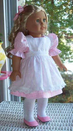 American Girl doll or 18 inch doll dress, pinafore, and hair clip. Pink gingham dress with eyelet embroiderery pinafore.