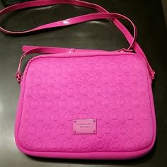 "Michael Kors Cross body Purse Hot Pink MK Logo 9"" x10""  x 1"" in sz so perfect for IPad or Tablet or possibly very small thin laptop or use as a crossbody. Inside is lined with soft suede. Great conditiin. Has an indentation on back from laying on something in my closet but will probably work itself out and isn't noticeable when carrying as its on the back. See 3rd pic. Reasonable offers only and No trades. Michael Kors Bags"