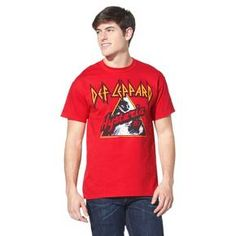 """Celebrate heavy metal history with the Def Leppard Men's T-shirt. This bright red tee shirt features the band name along with a screen printed version of the cover art for their 1987 album """"Hysteria."""" Made of comfy 100% cotton with a classic crew neck."""