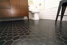 Beautiful black hexagon floor tiles with in-floor heating!   A Light and Bright Tudor Remodel | Design*Sponge