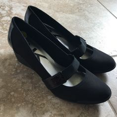 Anne Klein black wedges These are from the Anne Klein Sport collection, deigned to offer a more comfortable shoe. Excellent condition. Wedge height is approximately 2 inches, has an elastic strap, and patent details Anne Klein Shoes Wedges