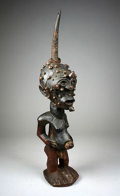 Power Figure: Male (Nkisi).  19th–20th century.  Democratic Republic of the Congo.  Songye peoples Medium: Wood, metal studs, horn, snakeskin, string.