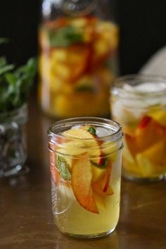 Sangria Recipes-Fruity Recipes for Sangria-MANGO, MINT, AND PEACH SANGRIA.This colorful drink is bursting with fruity flavors that will give you serious summer vibes. Visit redbookmag.com for more sangria recipes.