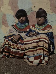 638087. Two Seminole Indian girls sit in one of the Indian villages of Miami. Miami, Florida, USA. c. 1920s