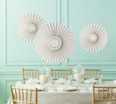 With die-cut doily centers, these hanging rosettes add a pretty, feminine touch to parties, weddings, and showers.