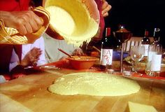 Soft Polenta Recipe : Michael Chiarello : Food Network - FoodNetwork.com.  This can be served with pesto, meat sauce, and anything else that sounds good to you!