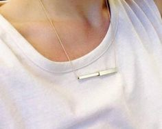 long tube minimalist necklace with gold element by StudioBALADI