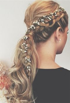 Wedding Ponytails: Braided Ponytail with Flowers | For more inspiration visit www.weddingsite.co.uk