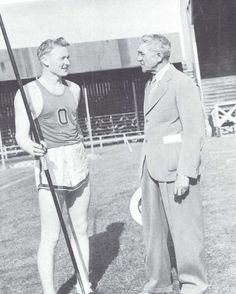 1940 UO all-american javelin star Boyd Brown talks with coach Bill Hayward. Brown set records despite lacking a thumb on his throwing hand.  From the 1941 Oregana (University of Oregon yearbook).  www.CampusAttic.com