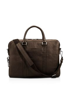 Slim and lightweight, this handsome leather briefcase from Shinola stores all your office essentials and features a detachable shoulder strap for a hands-free commute. Briefcase For Men, Leather Briefcase, Leather Bag, Shinola, Embossed Logo, Slim Man, Gym Bag, Shoulder Strap, Man Shop