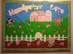 Handprint Farm ... use baby handprints to make cows, horses, and pigs ... also used handprints to colour the title. :-D