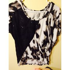 Calvin Klein top Ck fashion top mix with sequins. I only have worn twice, and this top is in an excellent condition. It's xs, but i think it's oversize style. Girls who usually wear S or M both can fit. Calvin Klein Tops