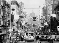 Milwaukee Downtown Facebook Post - No shortage of signage on Wisconsin (Grand) Avenue c. 1930