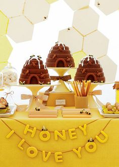 Amy Atlas' new book, Sweet Designs hits the shelves next week. It's a mega-manual of sugar and crafts that will help you create beautiful dessert tables like this one from the book called Honey, I love you.