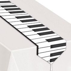 Make a music party jump to life by singing a tune as you decorate with the Piano Keyboard Party Tape. The Piano Keyboard Party Tape can be used to decorate in muliple different ways. The Piano Keyboard Party Tape can be used indoor or outdoors. Music Party Decorations, Party Themes, Party Ideas, Music Centerpieces, School Centerpieces, Party Centerpieces, Table Runner And Placemats, Quilted Table Runners, Bonny Und Clyde