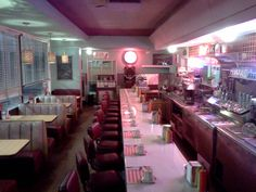 Classic, vintage 1950s diner scene; that pink light just feels so inviting