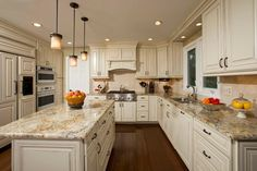 Image result for light cabinets with dark granite