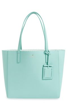 Carry all the essentials in this spacious leather tote from Kate Spade. The bow-topped luggage tag even opens to reveal a little mirror perfect for quick touch-ups.