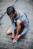 Young black runner ties his shoe befor a run in the street. by BONNINSTUDIO - Stocksy United Urban Fitness, Black Runners, Shoes Photo, Photo Search, Young Black, Tie Shoes, Hot Guys, Royalty Free Stock Photos, Sporty