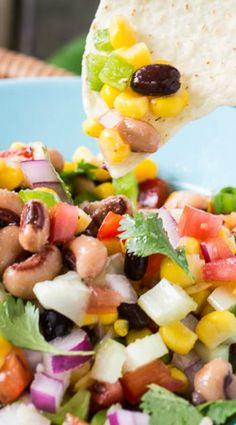 Texas Caviar Bean Dip ~ Texas Caviar with black-eyed peas, black beans, corn, red bell pepper, and red onion can be eaten as a dip or as a side salad.