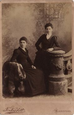 Cabinet photo of 2 victorian girls taken in Blandford, Dorset around 1890s by Tom Nesbitt (born 1850) at his studio located at Market Place.