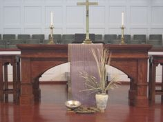 Ash Wednesday altar: jute/stones representing Christ in the desert at the beginning of his ministry...dried palms/ashes representing the end of his ministry...purple behind the jute for the season of Lent