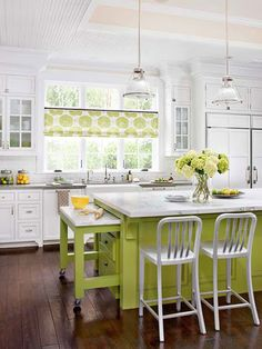 White kitchen with a pop of chartreuse. Like the idea just not the color. Love the island cutting board and drawers on the end.