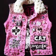 If Hello Kitty Was A Punk. I made some of my favorite punk bands into hand painted parody patches! When I was a gutter crusty punk i'd make these vests, or pants, filled with studs,zippers,earned patches, buttons, and more diy fashion! This Vest is hand painted, studded, sewed and lined carefully...
