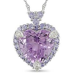 - Alluring necklace features a bright purple amethyst heart set amid frosty blue tanzanites Jewelry shimmers in white gold Heart pendant necklace with icy diamond accents is a beautiful gift for someone special Heart Jewelry, Cute Jewelry, Bling Jewelry, Jewelry Accessories, Silver Jewelry, Amethyst Jewelry, Fashion Accessories, Purple Gold, White Gold