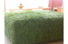 artificial turf ottoman. available at Pomp in los angeles.