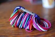 Organize your hair elastics with a carabiner.