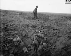 Troops of the 2nd Canterbury Battalion, New Zealand Division, rest in a shell hole, Battle of Flers-Courcelette. 15 September 1916.