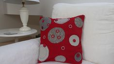Cushion cover in red upholstery fabric decorated with appliqued circles in grey covered rings and buttons. The cover has an envelope opening.Please note because of the bulk you dont get sharp corners.Sold with a hypoallergenic cushion pad Free Motion Embroidery, Cushion Pads, Handmade Items, Handmade Gifts, Textile Art, Circles, Embellishments, Craft Supplies, Upholstery