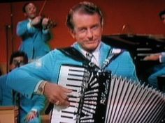 Myron Floren was an expert accordianist on the Lawrence Welk show and could play a mean Roll Out the Barel Polka. I tried to imitate him on my accordian. Dad and I took a trip to Frankenmuth to meet him and had our picture taken with him.