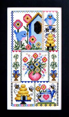 Bobbie G Designs Birds and the Bees - Cross Stitch Pattern. Model stitched on 14 Ct. White Aida using DMC floss. Stitch Count: 121H x 62W