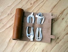 Cordito leather cord wrap that holds 3 cables and 2 plugs.